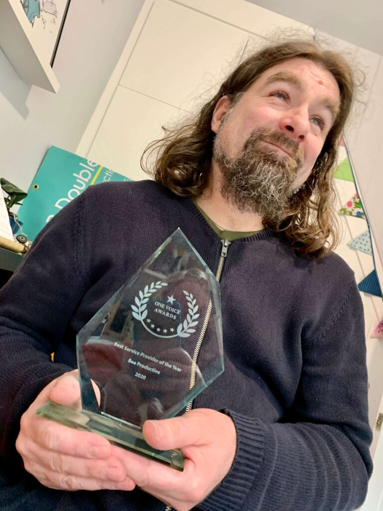 Rob Bee with his award